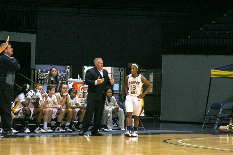 Ryan Richardson/The News Head Coach Rob Cross talks to junior guard Keiona Kirby, who is expected to take on the scoring role for the Racers this year.