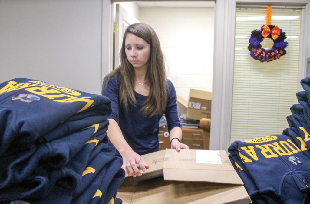 Jenny Rohl/The News Tori Gray, freshman from Harrisburg, Ky., folds sweatshirts in the University Bookstore.