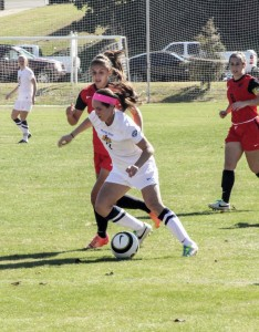 Jenny Rohl/The News Junior Julie Mooney pushes the ball past an Austin Peay defender in their last game Sunday.