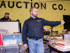 Megan Godby/The News Joe Bunch, senior from Wingo, Ky., auctions off items for his family's auction company.