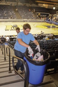 Jenny Rohl/The News Ryan Johnson, senior from Cape Girardeau, Mo., throws away leftover popcorn bogs and old sodas.