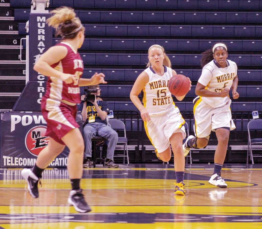 Jenny Rohl/The News Freshman Janssen Starks and senior Jessica Winfrey push the ball up the court in a 101-44 win against Robert-Morris Springfield Nov. 8.
