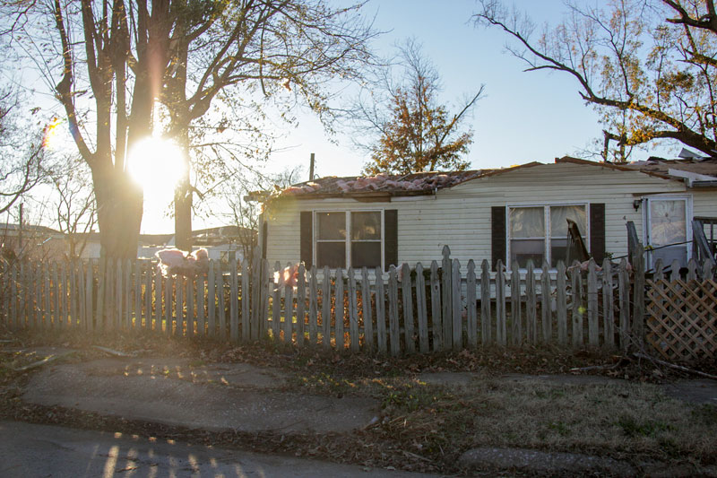 Lori Allen // The News /// The sun sets on Brookport the day after a tornado ripped the roof from this home on Ohio Street.