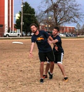 Kate Russell // The News  /// Grad student Ryan Curry, from Springfield, Ill. (left), tosses the disc as freshman Jacob Meadows, from Henderson, Ky., attempts to block.