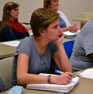 Megan Godby/The News Olivia Reed, graduate student from Bowling Green, Ky., takes notes during class.