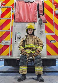 Ana Bundy/The News Drew Scott, sophomore from Flora, Ill., suits up for full-gear training. Scott has been a volunteer firefighter since September.