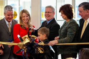 Lexy Gross/The News Henry Crisp II stands by his family as they cut the ribbon on the new Crisp Center in Paducah.