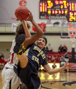 Lori Allen / The News Taylor Porter (1), freshman guard from Louisa, Ky., is overtaken by an SIUE player during the game there on Saturday.