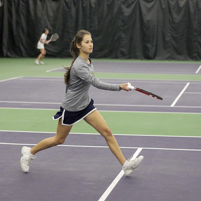 Lori Allen/The News Freshman Verginie Tchakarova returns the ball in the match Sunday.