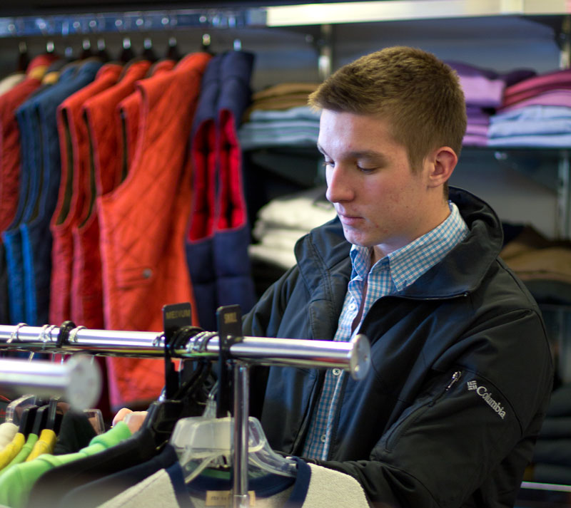 Fumi Nakamura/The News Dylan Baker, sophomore from Madisonville, Ky., shops for a new long-sleeve shirt at Dan's.