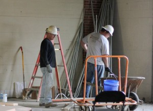 Lori Allen/The News Two workers examine their work while renovating the first floor of Business Building South.