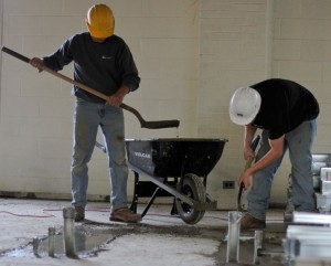 Kate Russell/The News Workers pour cement onto the floor in Businesss Building South. Construction is expected to be done by March.