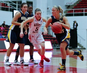 Kate RussellThe News Freshman point guard Janssen Starks (right) drives to the lane against Austin Peay earlier this season.