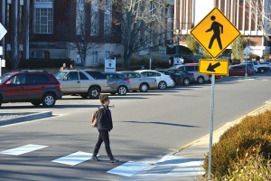 Photo illustration by Kate Russell, photo by Megan Godby/The News After months of bare road, 15th Street now has three crosswalks. The crosswalks were installed on Monday.