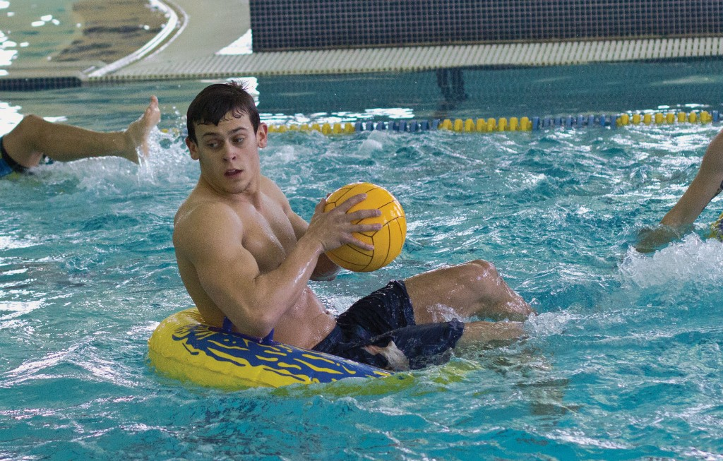 Fumi Nakamura/The News Alpha Sigma Phi's Nicholas Pray brings the ball up with junior teammate James Nance, during an intramural water polo match against Lambda Chi Alpha Sunday.