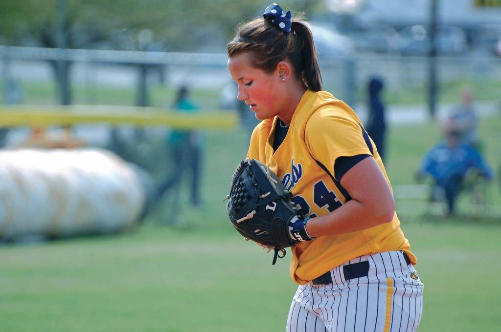 File photo Junior CheyAnne Gaskey gets set before delivering a pitch from the mound during the Racers last spring scrimmage.