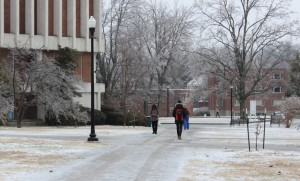 Students trek across ice-covered sidewalks Monday morning.
