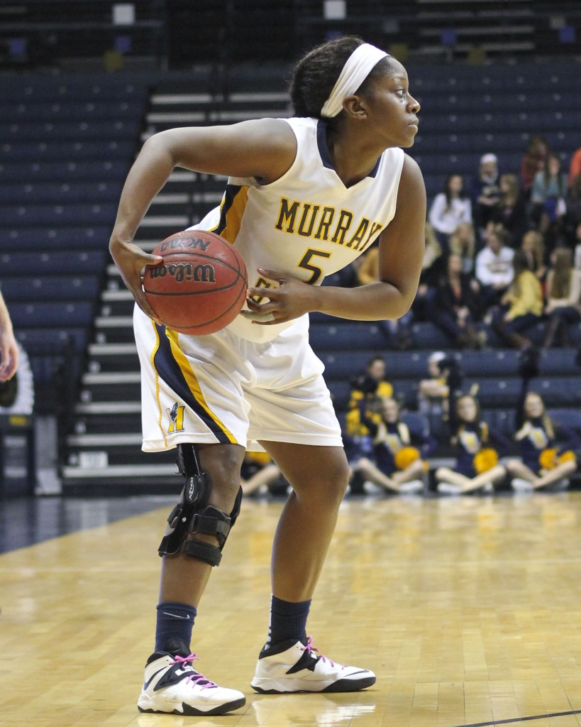 Kate Russell/The News Senior Jessica Winfrey looks for an open teammate in a game earlier this season.