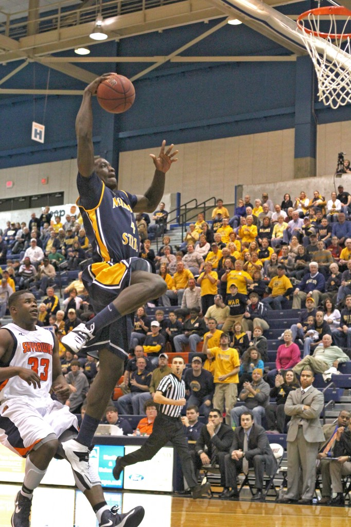 Senior forward Jarvis Williams rises up for a dunk in the Racers' win over UT?Martin Thursday night. || Photo by Kate Russell/The News
