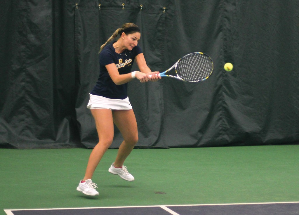 Jenny Rohl/The News Senior Carla Suga hits a shot in her three-set win against an Arkansas State opponent Saturday.