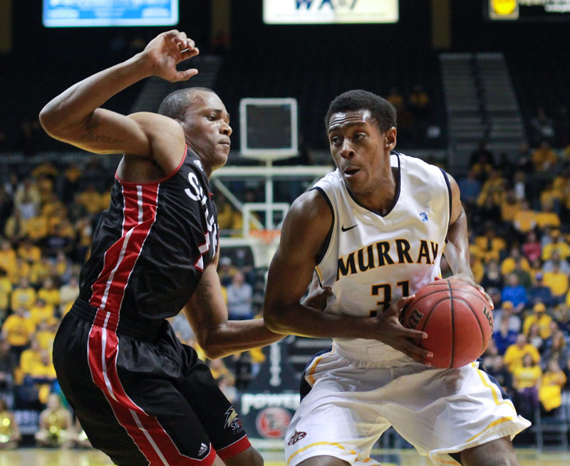 Fumi Nakamura/The News Sophomore guard Jeffery Moss drives prepares to pull up for a short jumper in the Racer's win.