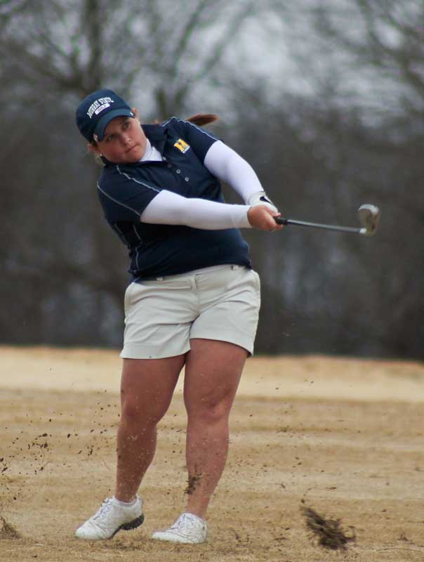 Jenny Rohl/The News Senior Delaney Howson watches her shot in the Racers' win at the Time Warner Racer Classic. Howson tied for first place in the tournament.