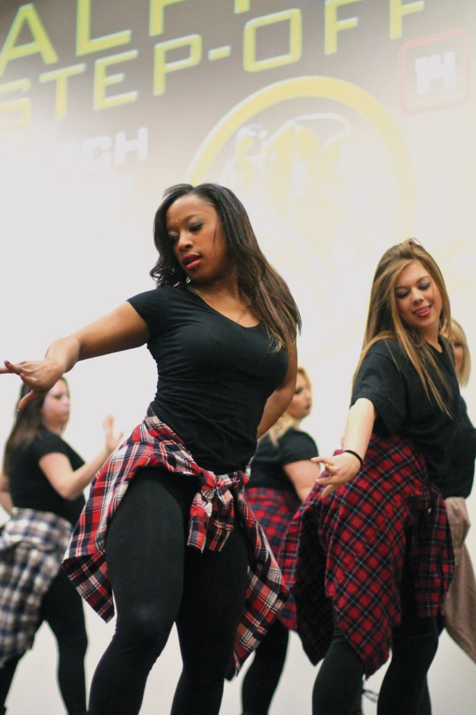 Jenny Rohl/The News Two members of Alpha Gamma Delta compete in Tuesday's stroll competition.