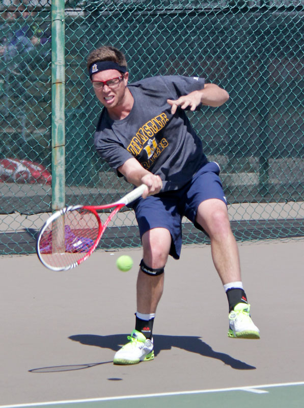 Lori Allen/The News Senior Adam Taylor returns the ball in a match against the University of Tennessee.