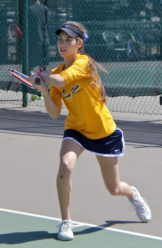 Lori Allen/The News Freshman Eleonore Tchakarova hits a backhand in Saturday's match.