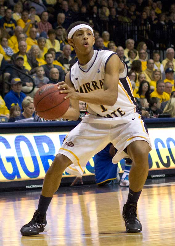 Fumi Nakamura/The News Freshman point guard Cameron Payne looks to pass the ball in a game earlier this year.