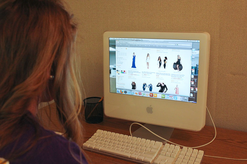 Kate Russell/The News Students surf popular websites to score deals on items such as clothing.