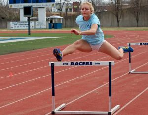 Jenny Rohl/The News Sophomore Lauren Miller jumps hurdles at the Marshall Gage Track in Roy Stewart Stadium in an outdoor practice earlier this week.