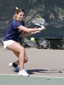 Lori Allen/The News Senior Carla Suga prepares to hit a backhand in her match Sunday.