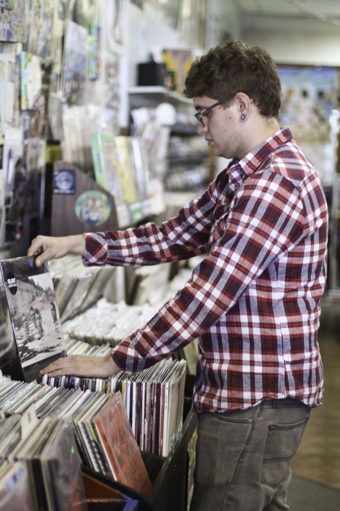 Jenny Rohl/The News Clint Baumgartner, senior from Henderson, Ky., browses through hundreds of vinyl records at Terrapin Station.