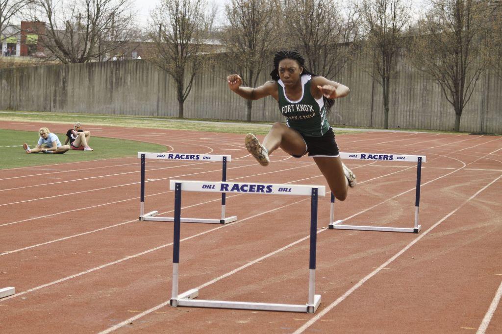 Jenny Rohl/The News Sophomore Kiara Austin jumps hurdles at practice.
