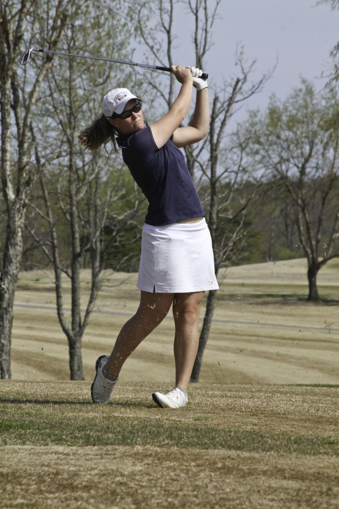 Jenny Rohl/The News Sophomore Abbi Stamper follows through a swing during practice.