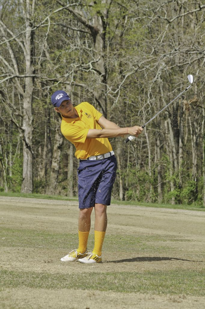 Jenny Rohl/The News Sophomore Jared Gosser follows through on his swing at a practice earlier this week.