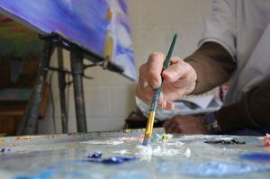 Kate Russell/The News A student uses one of the studios in Woods Hall to paint for a class assignment.