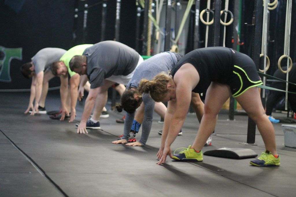 Jenny Rohl/The News Members of CrossFit Murray stretch before beginning the workout of the day, or W.O.D.