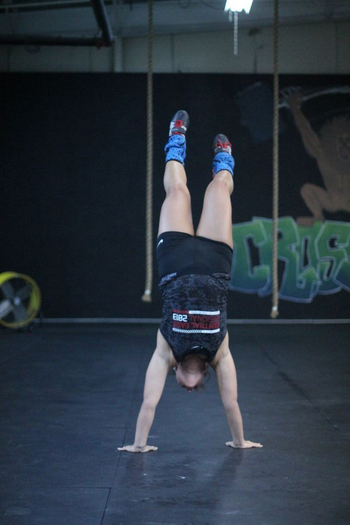Jenny Rohl/The News Lindsey Smith holds a handstand during a workout.