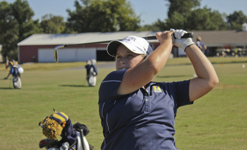 Senior Delaney Howson follows through on a swing in practice last semester.