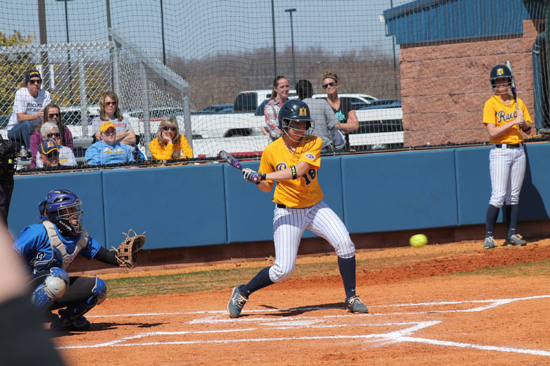 Jenny Rohl/The News Freshman Jocelyn Rodgers swings at a pitch in the Racers' doubleheader against Tennessee Tech.