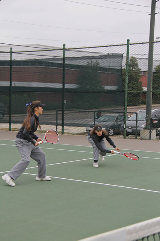 Lori Allen/The News Freshmen twins Eleonore and Virginie Tchakarova play together in a March 30 doubles match against Southern Illinois University Edwardsville.