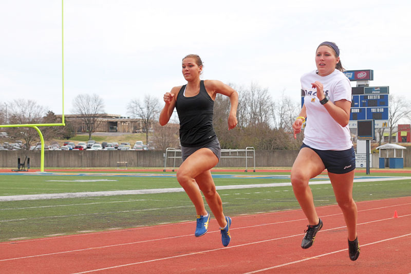 Kate Russell/The News Two members of the Murray State track team train at the Marshall Gage Track earlier this semester.