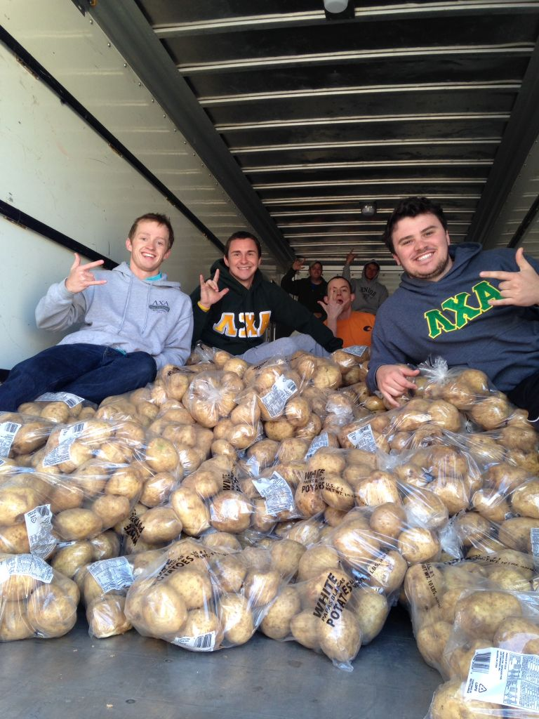 Photos courtesy of Barrett Pazderka Lambda Chi Alphas load potatoes into U-Haul trucks.