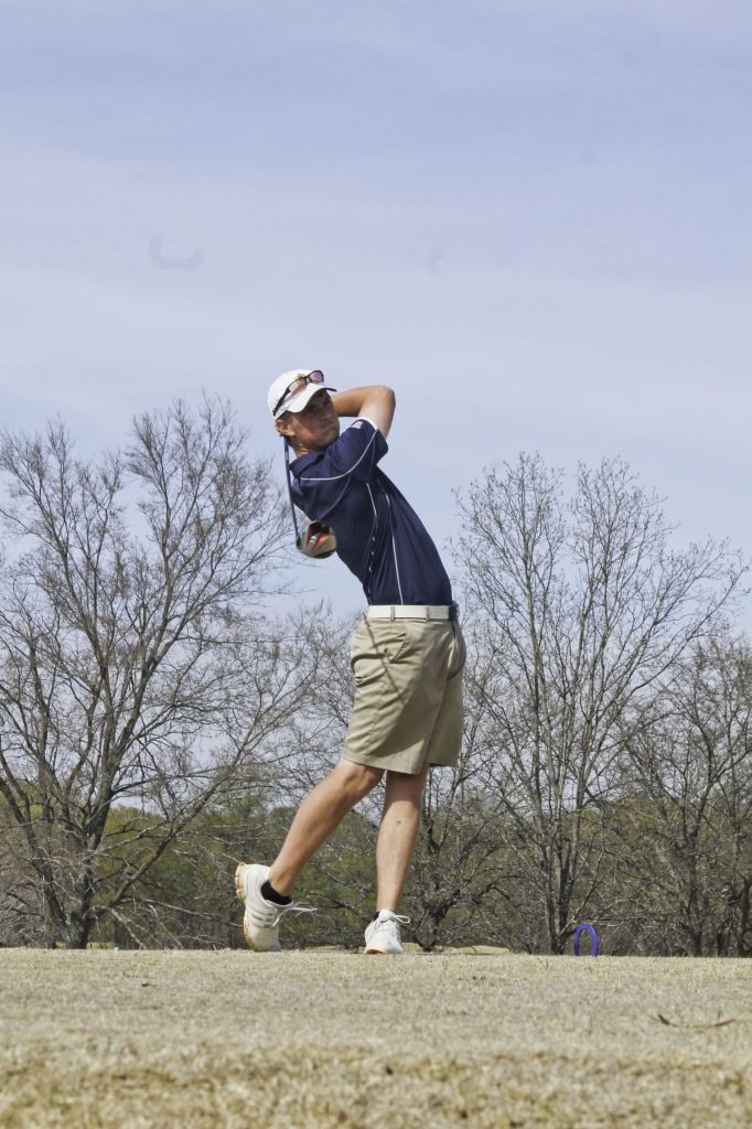 Jenny Rohl/The News Freshman Myles Morrissey practices at Frances E. Miller Memorial Golf Course April 17.