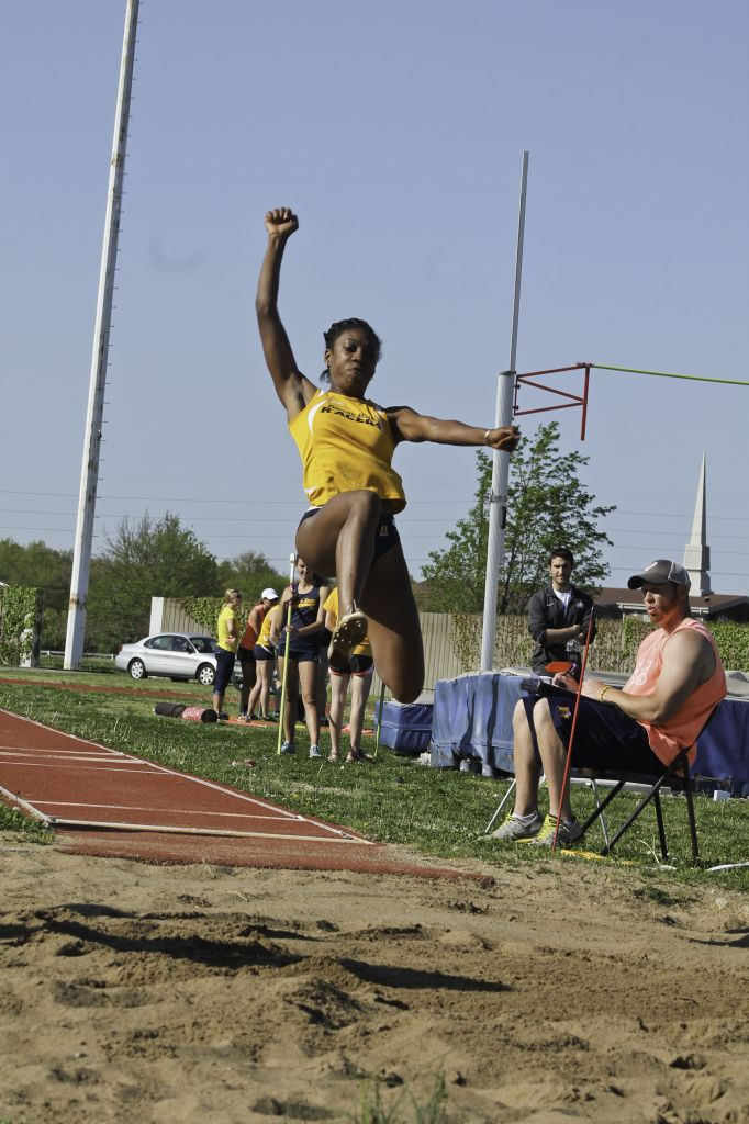 Jenny Rohl/The News Sophomore Kiara Austin jumps at the Battle of the Cumberland April 22.