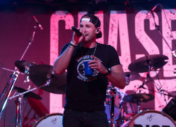 Fumi Nakamura/The News Chase Rice addresses the crowd before taking a drink and performing another song.