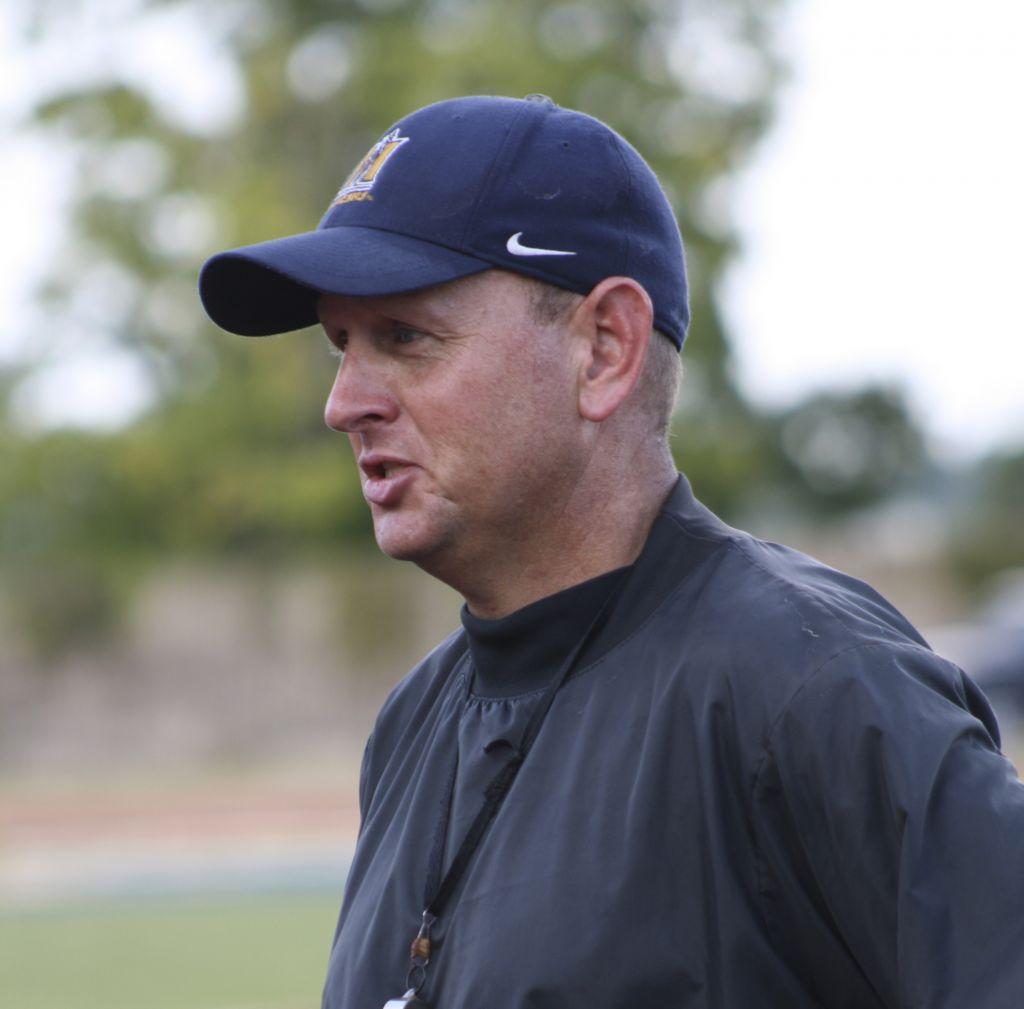 Kalli Bubb/The News Head Coach Chris Hatcher talks to his team during practice Monday at Roy Stewart Stadium.
