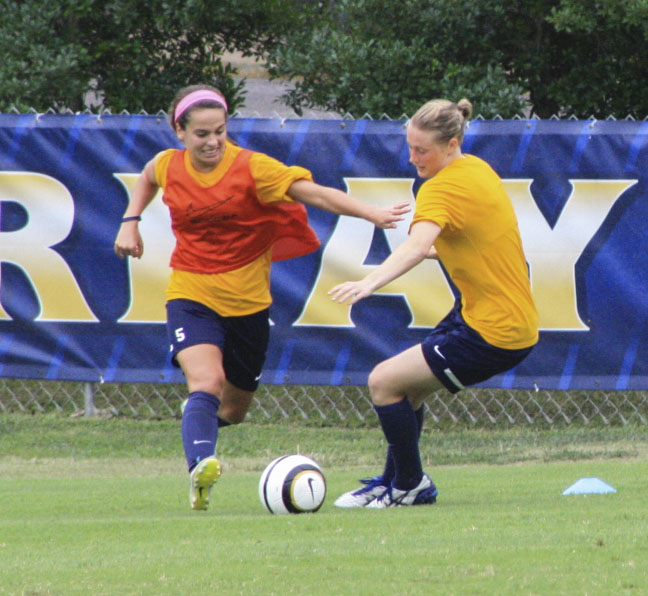 Kalli Bubb/The News Sophomore Taylor Richerson goes against freshman Harriet Withers during practice Tuesday.